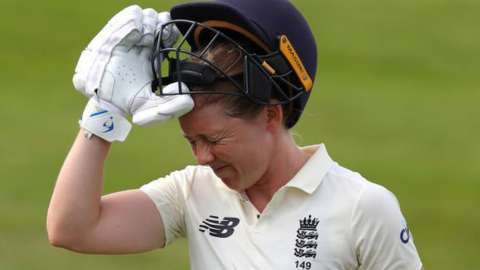 Heather Knight grimaces after being dismissed for 95