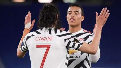 "Manchester United""s Edinson Cavani celebrates scoring their first goal with Mason Greenwood"