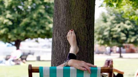 A woman relaxes in a deckchair in London's Hyde Park