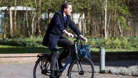 Prime Minister of the Netherlands Mark Rutte rides a bicycle