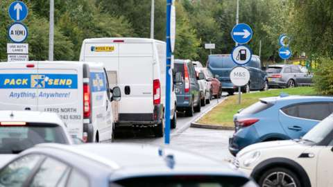 Cars queuing at a BP service station at Wetherby Services near Leeds