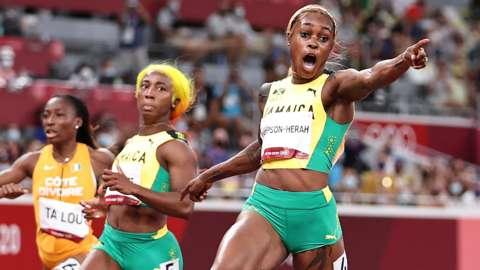 Elaine Thompson-Herah wins the women's 100m final as Shelly-Ann Fraser-Pryce looks on