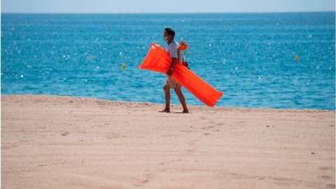 Man on beach in Spain