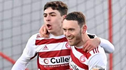 Hamilton celebrate a goal from Lee Hodson (right)