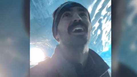 Ben Kielesinski looking amazed in an ice cave