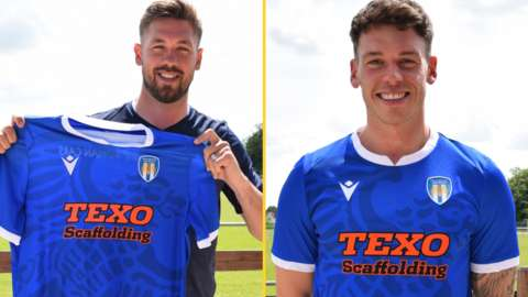 Luke Chambers (left) and Luke Hannant pose with a Colchester shirt
