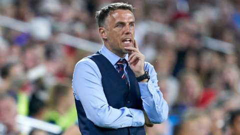 England women's manager Phil Neville watches from the touchline