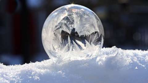 A bubble turning to ice