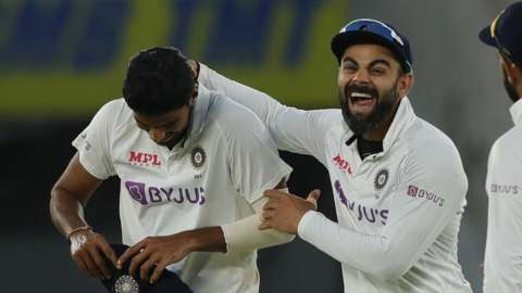 Virat Kohli celebrates with Washington Sundar