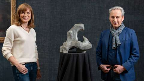 Fiona Bruce and Philip Mould with the sculpture