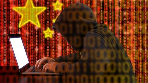 Arty picture of Chinese hacker, using binary code to make up image.