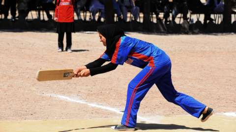 A woman playing cricket in Afghanistan in 2013