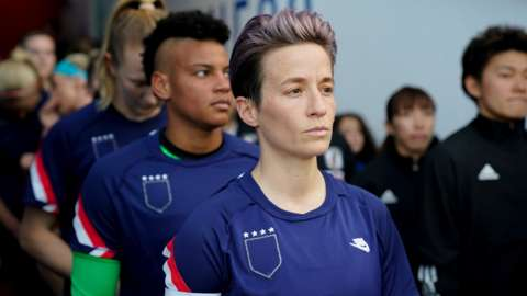 US Women's striker Megan Rapinoe prepares to lead the team out at the SheBelieves cup with her jersey turned inside out to hide the badge