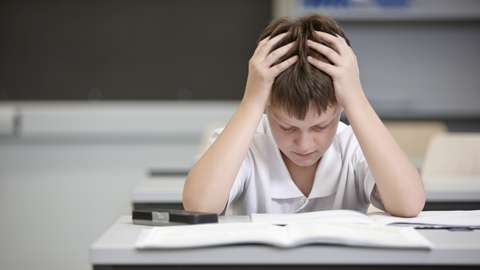 schoolboy concentrating on his work