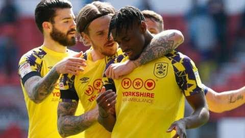 Huddersfield celebrate Aaron Rowe's opener