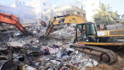 Excavators work to clear the rubble at the site of Israeli air strikes, in Gaza City May 16, 2021