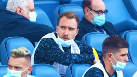 Eriksen sat in the stands
