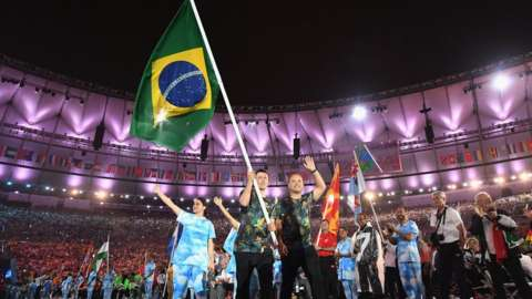 Brazilian 5-a-side Football gold medalist Ricardinho carries the Brazilian flag into the Maracan Stadium during the closing ceremony of the Rio 2016 Paralympic Games