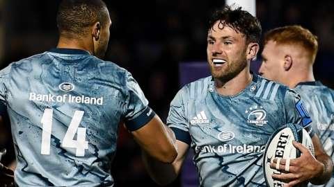 Leinster's Hugo Keenan celebrates scoring a try