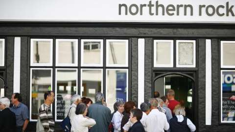 Customers queue outside a Northern Rock branch in 2007