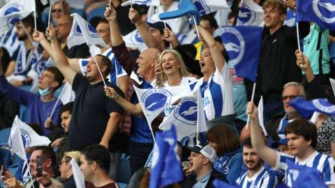Brighton fans with flags