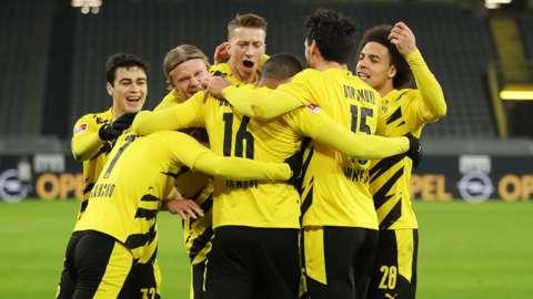 Borussia Dortmund's players celebrate scoring against Wolfsburg in the Bundesliga