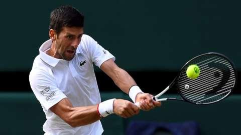 Novak Djokovich playing at Wimbledon 2019
