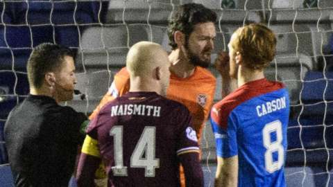 Craig Gordon of Hearts confronts Inverness midfielder David Carson