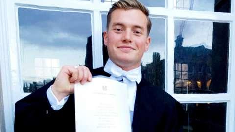 Jack Merritt holding a certificate