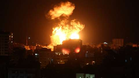 Smoke and flames rise after Israeli fighter jets conducted airstrikes in Gaza City, Gaza
