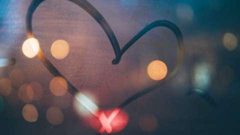 A heart drawn in steam on a window
