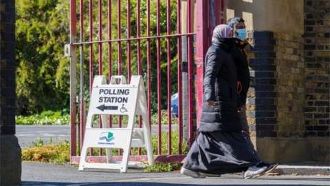 People leave a polling station in Tower Hamlets, London, Britain, 06 May 2021