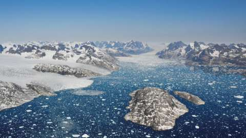 Masses of ice break off from the edge of a glacier, Heinesen Fjord, Greenland