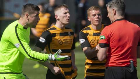 Neil Parry protests his red card