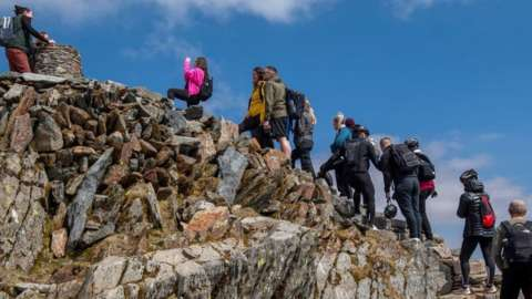 People queuing at the top of Snowdon