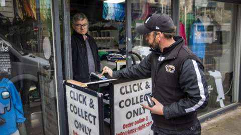 A customer uses a click-and-collect service in Northern Ireland