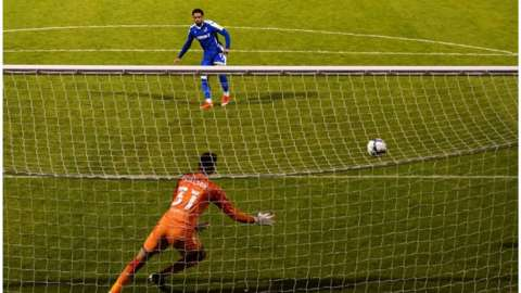 Trae Coyle struck Gillingham's winning penalty in the shoot-out to earn a third-round trip to either Wolves or Stoke