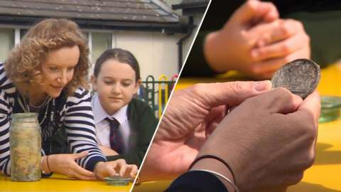 A teacher and pupil with the time capsule