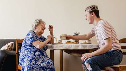 young man and elderly relative in care home