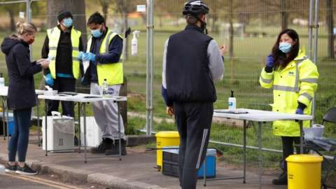 People take coronavirus tests on Clapham Common in London