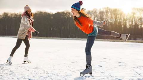 Two women ice skating