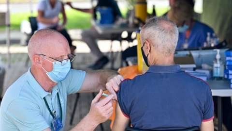 Man receiving vaccine in Glasgow
