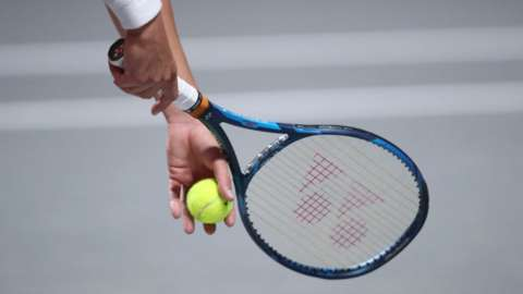 A tennis racket and a tennis ball