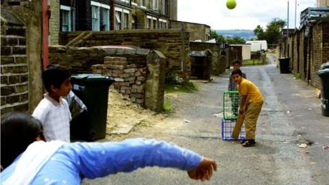 Boys playing cricket in Bradford in 2001