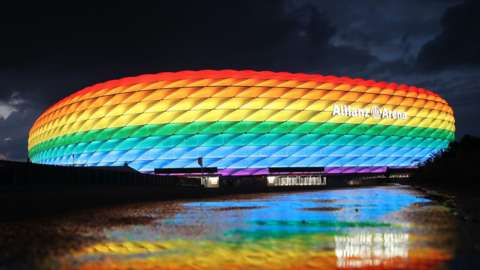Allianz Arena lit up in rainbow colours
