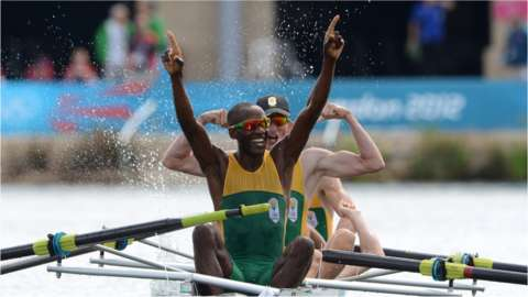 Sizwe Ndlovu and teammates react to crossing the line first at London Olympics