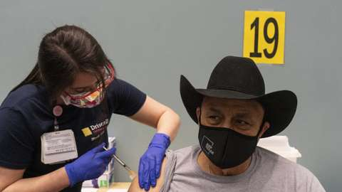 A person receives the Moderna Covid-19 vaccine at the American Bank Center in Corpus Christi, Texas