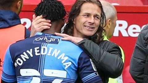 Wycombe boss Gareth Ainsworth consoles Fred Onyedinma