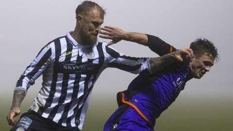 St Mirren's Richard Tait challenges Dundee United's Ian Harkes