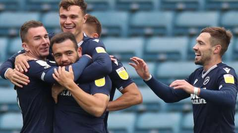 Millwall players celebrate scoring a goal against Brentford
